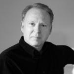Man with short hair wearing a black shirt